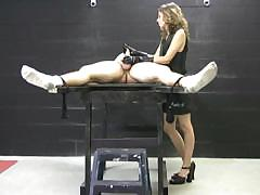 mistress in latex gloves masturbates a naked, tied up man