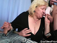 blonde-granny-gets-slammed-by-two-dicks
