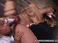 kinky-asian-babe-in-bondage-receives-a-nasty-dildo