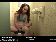 pissing-lez-use-anal-toy-strapon