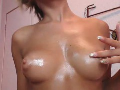 hot-girl-oiling-her-tits-and-fooling-around