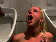 piss-slut-drinks-warm-pee-in-urinal