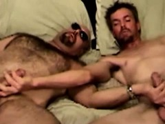 mature-duo-in-bed-tugging-together