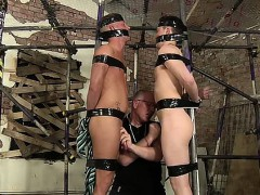 two-boys-full-of-cum-and-tied-to-a-scaffolding