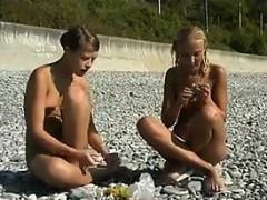 sweet-naked-girls-having-fun-at-a-beach