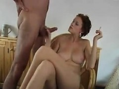 milf-smokes-and-strokes-on-a-hard-cock