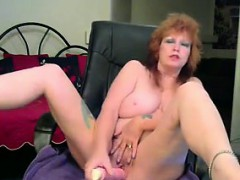 dirty-tattooed-granny-plays-with-her-dildo