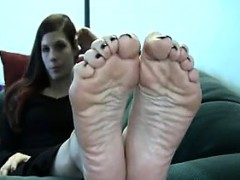 wife-showing-her-beautiful-soles-up-close