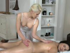 Blonde masseuse fingers brunette customer