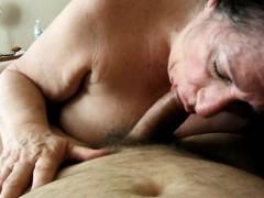 brunette-granny-giving-oral-sex-to-her-lover