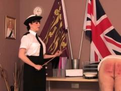 police-dominatrix-paddles-colleague-over-desk