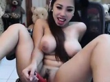 Asian Slut With Large Breasts Masturbating