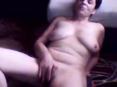 naughty-grandma-strips-and-rubs-her-pussy