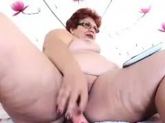 fat granny masturbates with a toy