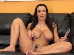 big-tit-milf-lisa-poses-on-the-couch-and-fingers-her-wet-snatch