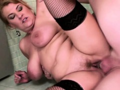 brunette mature gets pissed on in a restroom