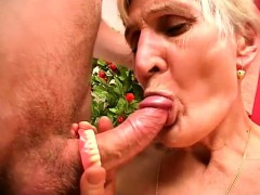 Horny blonde granny takes her dentures out and sucks a prick