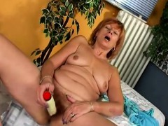 naughty-redhead-cougar-spreads-her-legs-and-drives-herself-to-orgasm