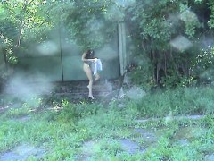 a-sexy-babe-in-a-miniskirt-is-stalked-into-the-forest-on-a