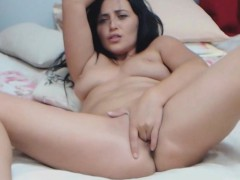 gorgeous-dark-haired-babe-masturbates