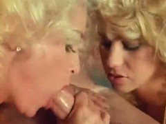 two-blondes-licking-cock-in-classic-porn