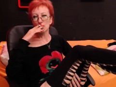 hot-redhead-lady-with-glasses-enjoys-a-cigarette-and-loses