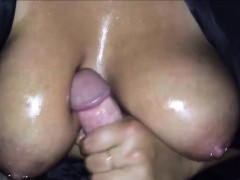cumming-on-her-giant-oiled-up-tits