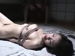 bound-asian-slave-endures-hot-candle-wax-drippings-in-a-bds