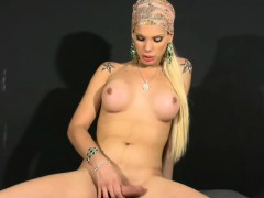 transsexual-with-long-blonde-hair-plays-with-shaft-and-balls
