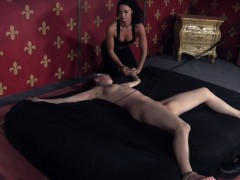 gagged-sub-restrained-to-a-bed-and-whipped