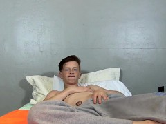 hot-twink-elijah-young-enjoys-a-hard-stroke-and-ass-play
