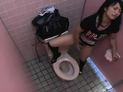 Buxom Japanese girl finds a place to feed her desire for ma