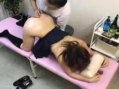 doctor gives a schoolgirl some muffin action on her back and