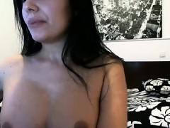 busty-brunette-in-her-room-shows-her-tits