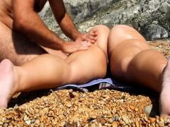 providing-her-a-sensual-rub-in-the-beach