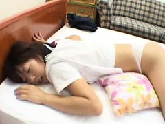 Asian Schoolgirl Lies On Her Stomach Showing Her Ass To Her