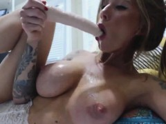 sexy-milf-in-lingerie-sucking-a-dildo