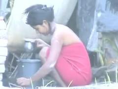 indian-girl-washing-outdoors