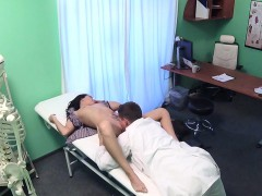 doctor-checking-breasts-to-sexy-patient