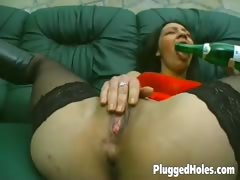sexy-girl-sticks-a-bottle-in-her-pussy