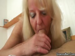 naughty-granny-in-stockings-rides-cock