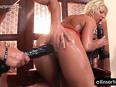 oily-tramp-takes-huge-dildo-and-fist-up-in-her-cunt