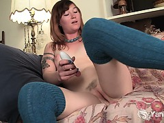 sexy-turquoise-pleasing-herself-with-toys