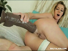stunning blonde stretching her tight booty with a brutal dildo