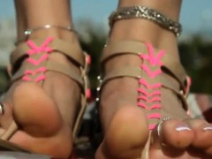 wearing-sandals-on-her-beautiful-feet-outside