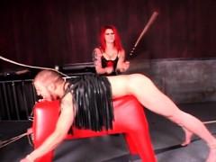 redhead-dominatrix-torturing-male-sex-slave