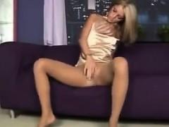 blonde-babe-in-pantyhose-using-her-dildo