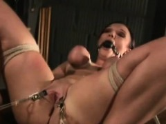 Busty brunette feels the pain of tight boobs bondage