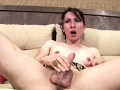 Brunette Shemale Covers Her Throbbing Dick With Sticky Honey