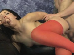 Two Guys Roughing Up Brunette Together On A Sofa